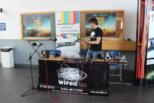 Ray Burke (Station Manager) setting up the Wired FM desk for the O.B. at the Festival.